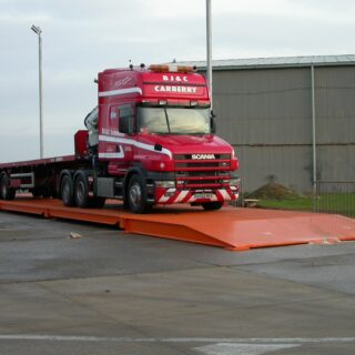 A picture containing sky, outdoor, red, truck Description automatically generated